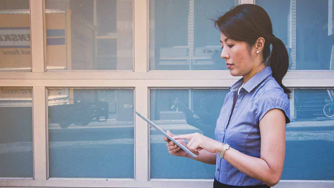 woman taking notes at business meeting technology partner Complete Network